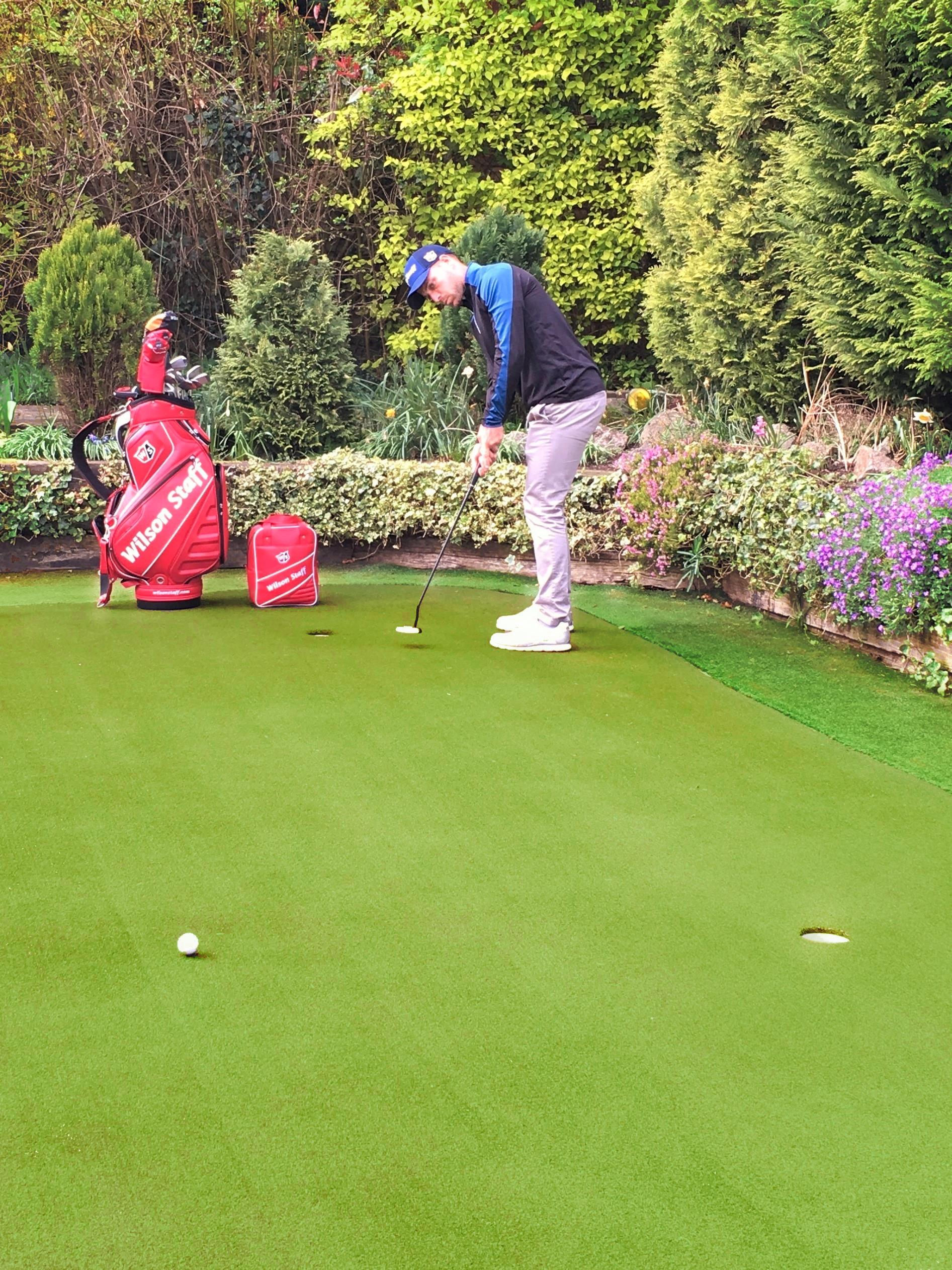 Gary King practises at home on his Huxley Putting Green